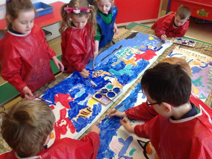 "This is P2 working on a frieze entitled ""Under The Sea"" using paint and collage"