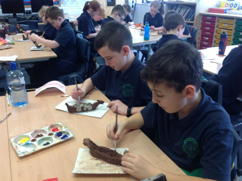 This is P6 working on their Viking boats made from clay