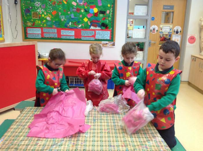 This is P2 making jelly fish from plastic bags and tissue paper.