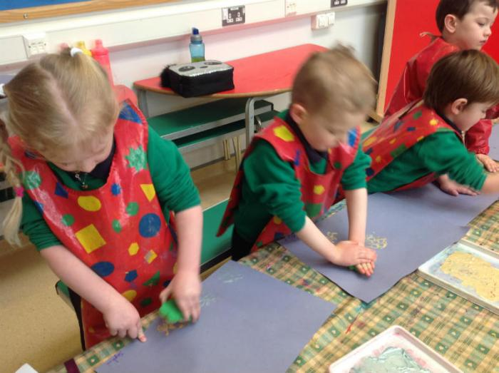 Primary 1 using bug stamps.