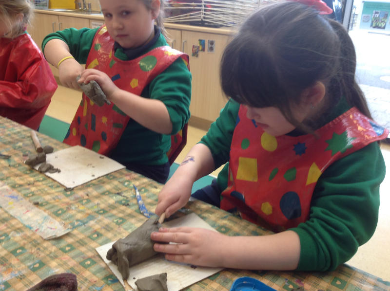 P2 making their own fish from clay.