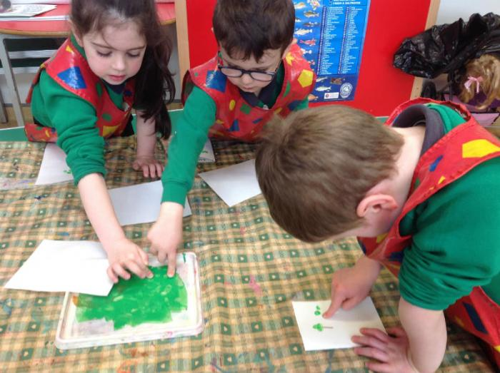 P1 making their St Patrick's day cards with finger prints.