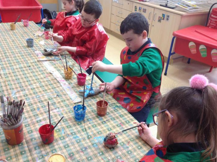 P2 painting their sea creatures.